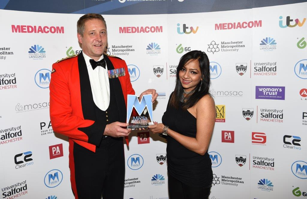 Colonel Russ Miller OBE presents the TV channel of the Year award to Star Plus